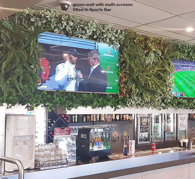 Green-Walls with multi-TV screens in Sports Bar...