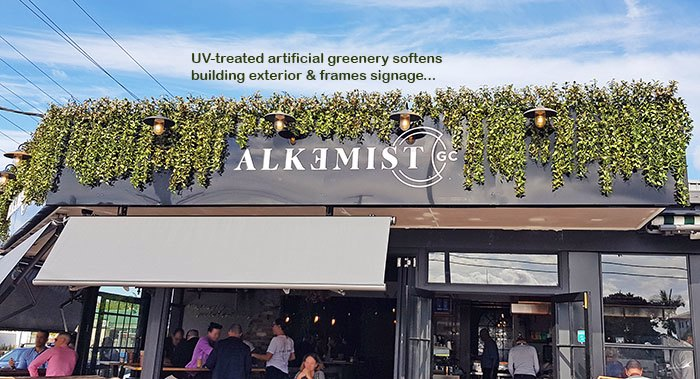 UV-treated artificial greenery softens Cafe facade & frames signage...