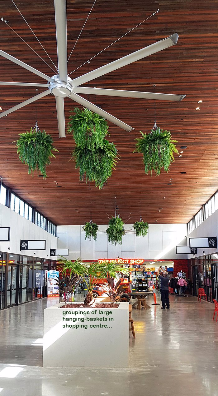 Lush green & dazzling lights- huge artificial hanging-baskets in shopping centre