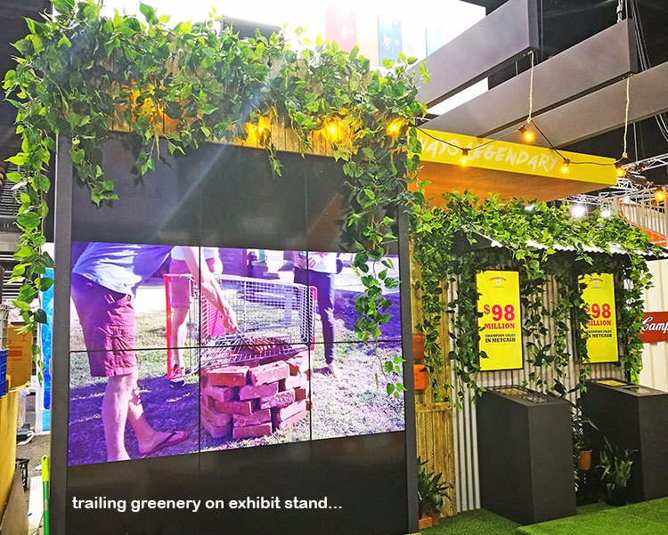 artificial Greenery to theme on exhibition display booth...