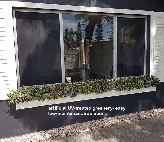 UV-treated artificial plants dress-up commercial building facade...