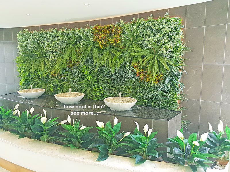 artificial plants are solution for tranquil Foyer Fountain setting...