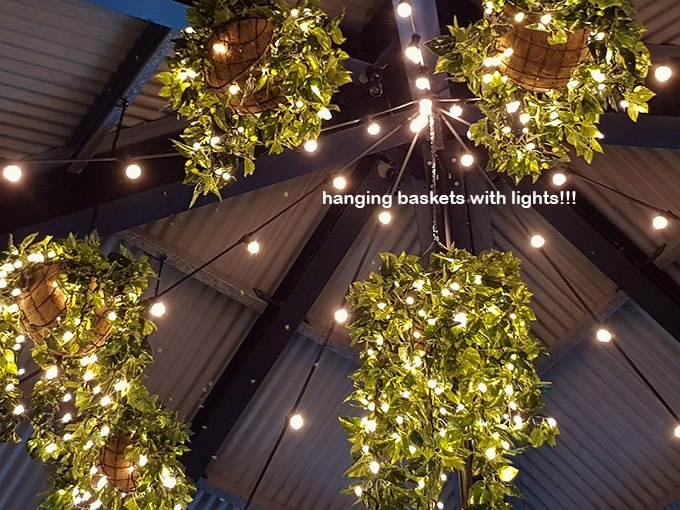 Hanging-Baskets with lights brighten up marina restaurant...