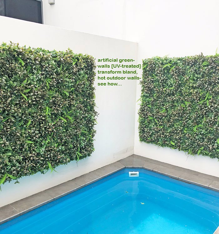 Concrete walls to green oasis with artificial plants...